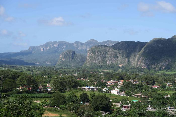 Viñales valley in the Province of Pinar del Rio is known worldwide for the production of the finest cigars and for its typical geological steep hills, the Mogotes. Pinar del Rio, Cuba.