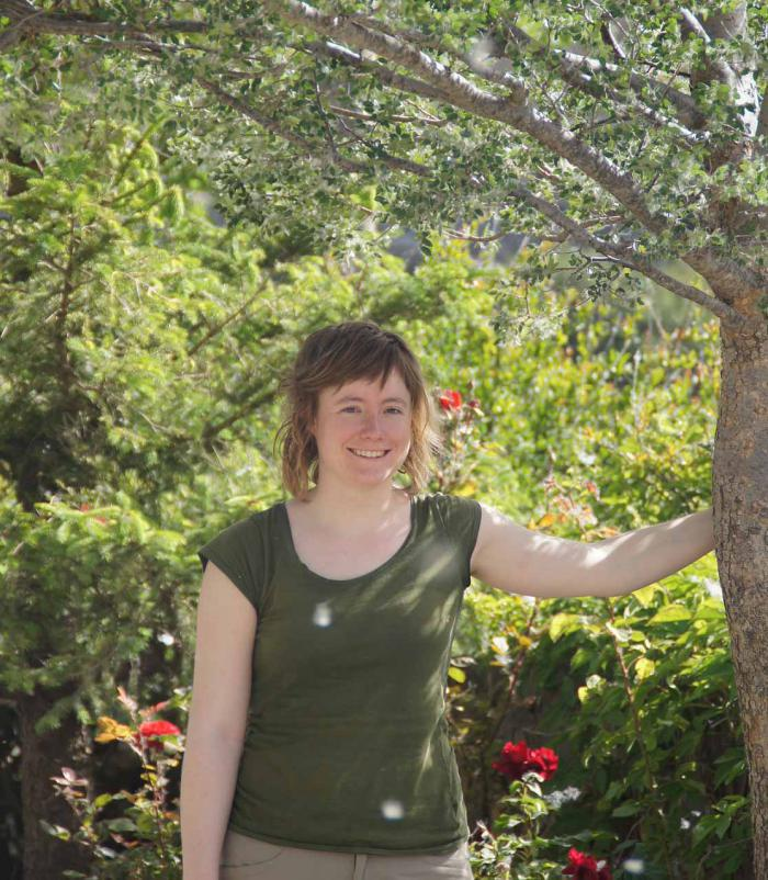 PhD student Laurence Fazan in front of a planted Zelkova abelicea tree in a private garden in western Crete.